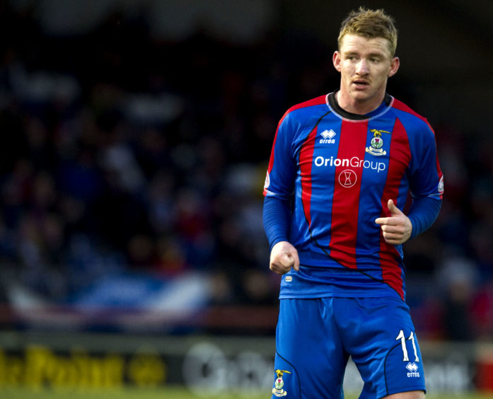 A young Hayes in action for Inverness