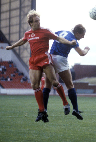 Rummenigge in action against Rangers in a 1986 friendly