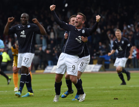 Peaso celebrates putting Dundee 2-0 up against Dumbarton in match that clinched Championship title