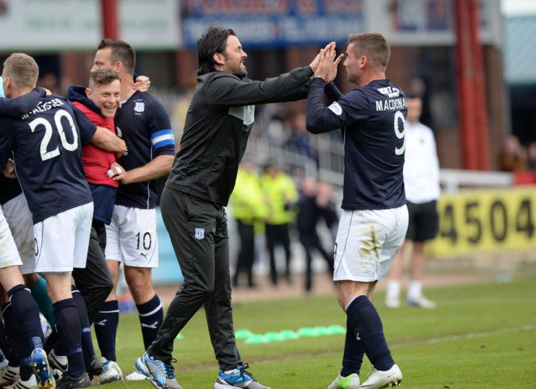 MacDonald celebrates with former Dark Blues gaffer Paul Hartley