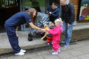 Wildlife Centre staff member Jade Johnstone presents the Stewart kids with cuddly toy animals.