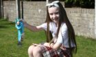 Catherine with one of her previous Kiltwalk medals.