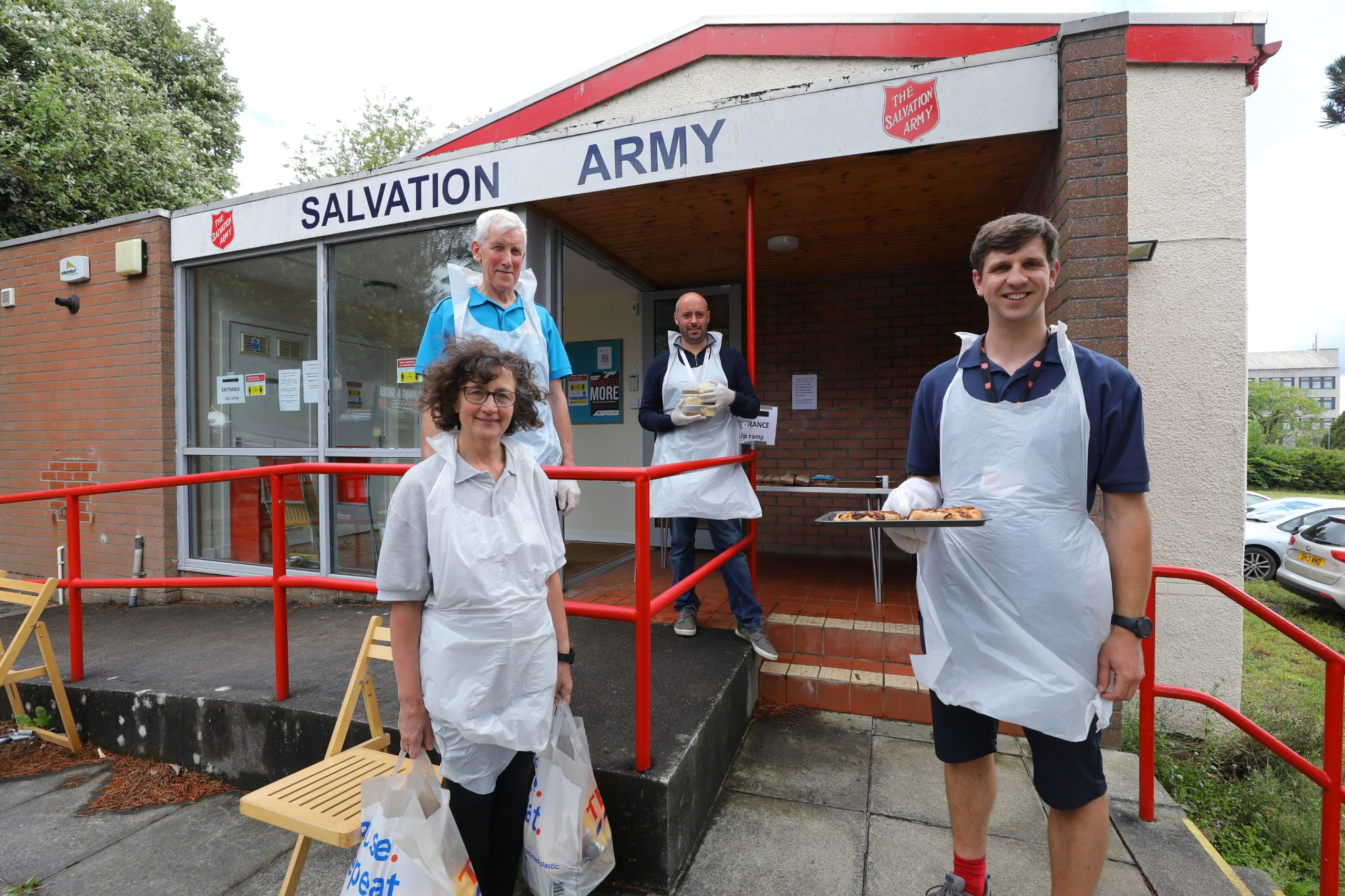 L-R: Carol Tucker, Gordon Tucker, Chris McAuley and Dean Bromage preparing to hand out food to the needy. (Picture: Dougie Nicolson / DCT Media)