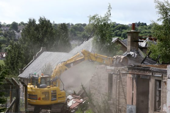 Demolition crews at work on the site of the former Strathmartine Hospital (Picture: Dougie Nicolson / DCT Media.)