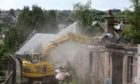 Demolition crews at work on the site of the former Strathmartine Hospital earlier this year.