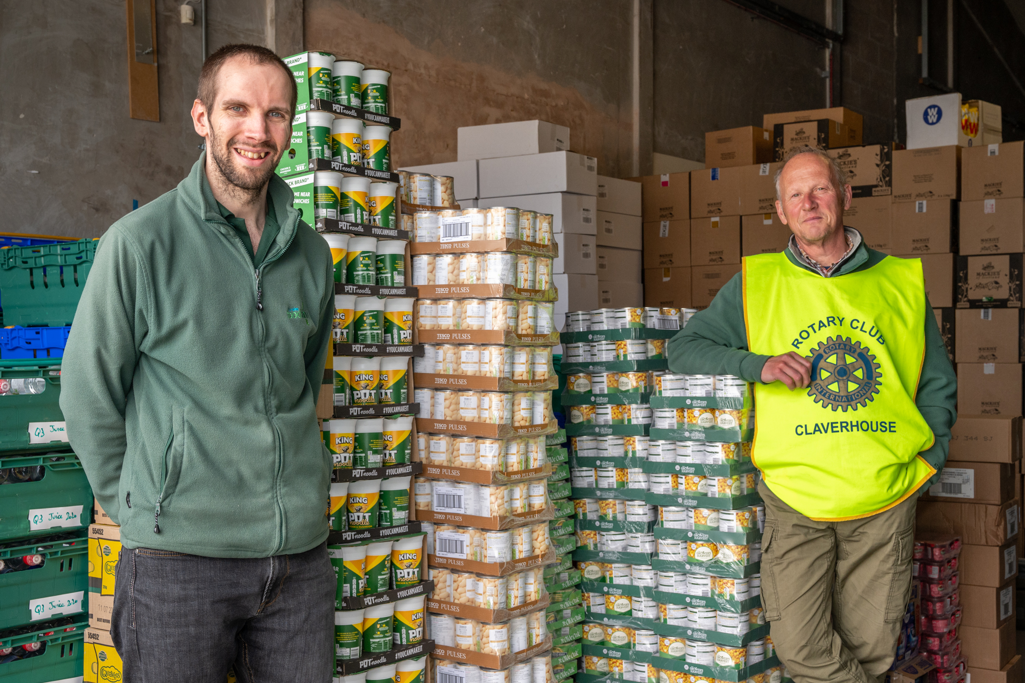 Michael Calder, warehouse manager at Dundee Foodbank, with Nick White, a Claverhouse Rotarian and food bank volunteer