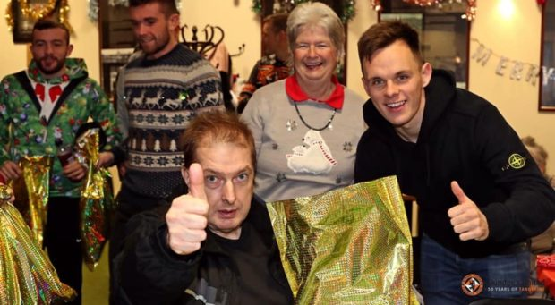 A group, including Lawrence Shankland, enjoying the Festive Friends fun at Tannadice at last year's event.