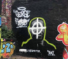 The defaced mural of George Floyd, who died while being restrained by a police officer.