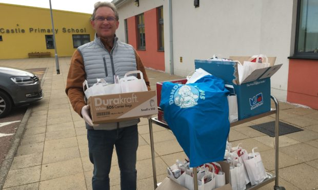 Doug Milne who volunteers regularly at Dundee Bairns alongside his partner, Jen Clark, with just some of the lunches provided by the group.