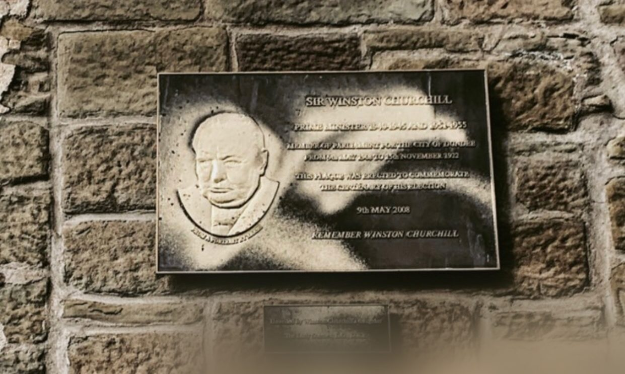 A defaced plaque in Dundee.