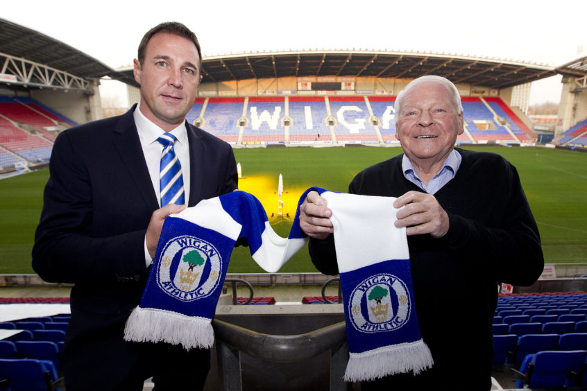 Malky Mackay alongside Dave Whelan after being unveiled as Wigan boss