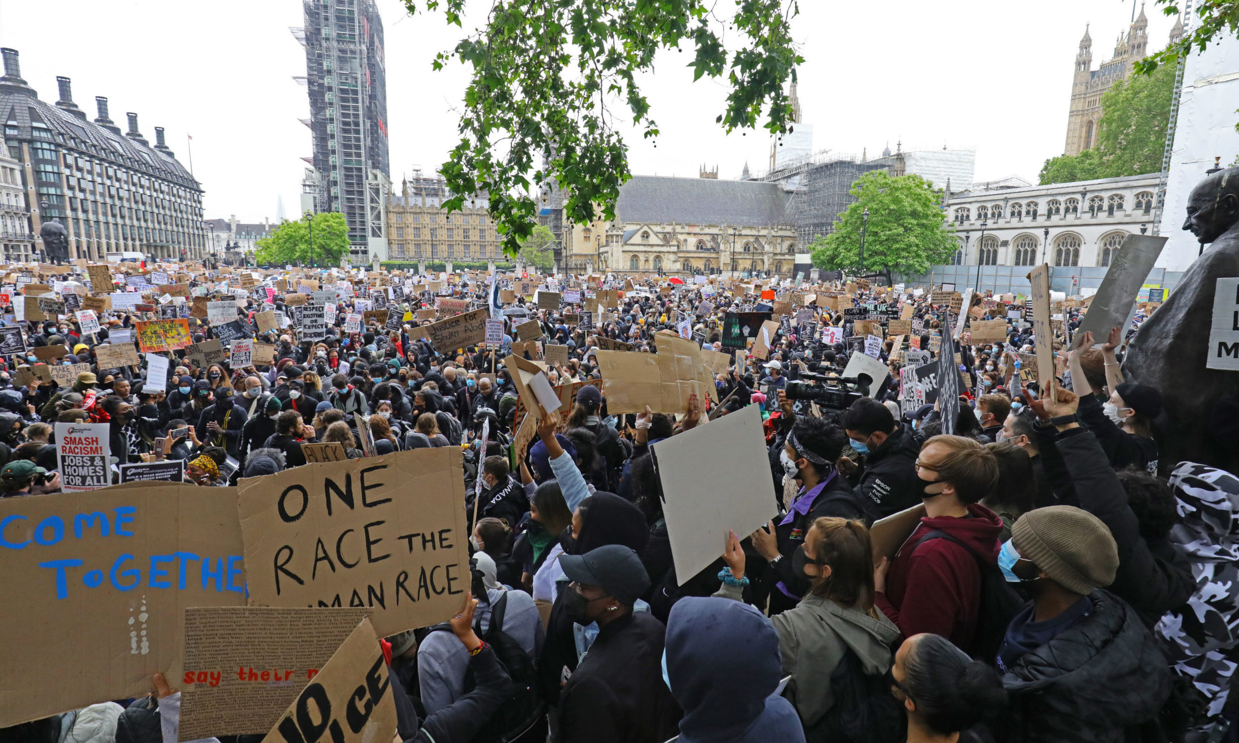 People take part in a Black Lives Matter protest rally in Parliament Square, London.