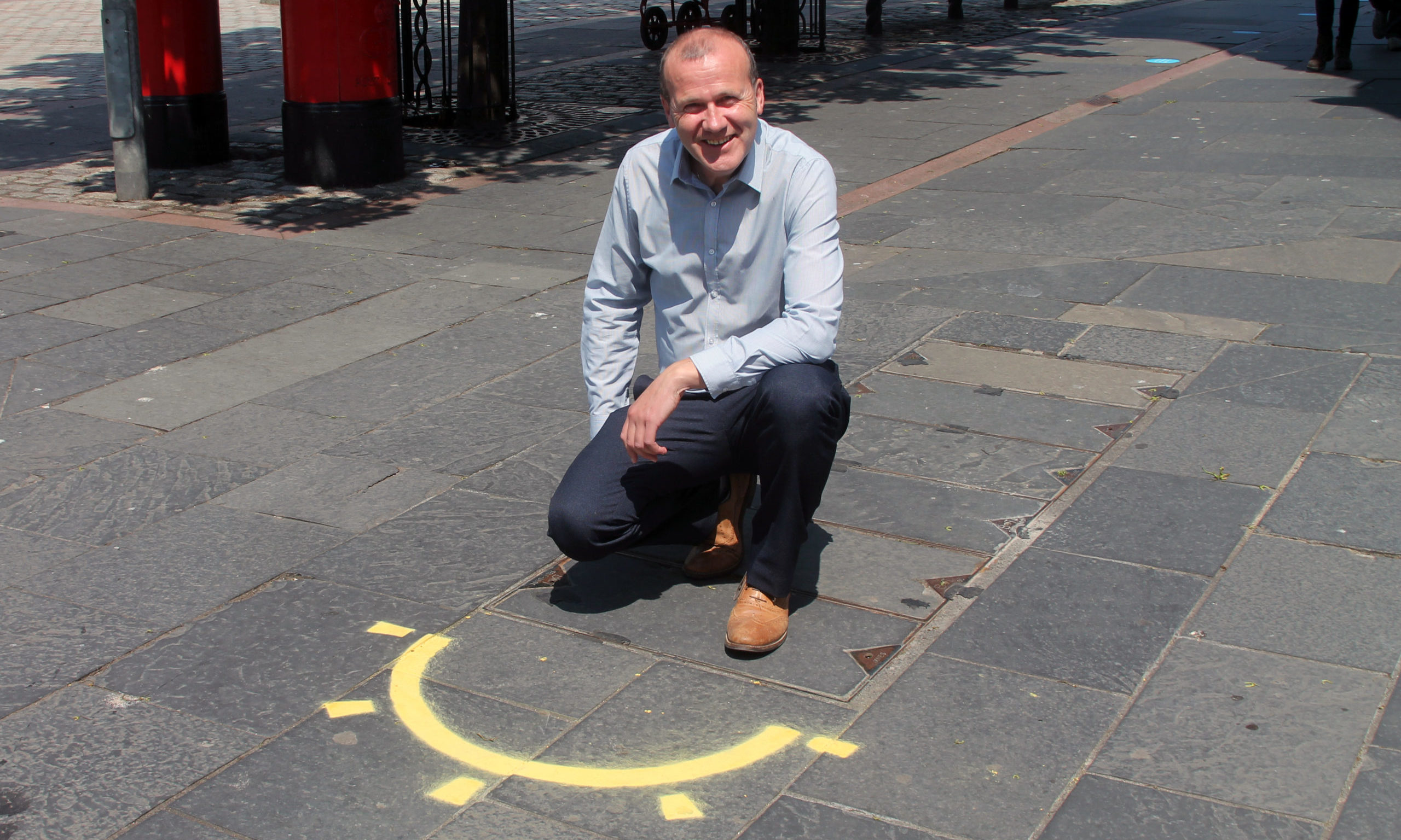 Councillor Mark Flynn, depute convener of city development, with one of the sunny Dundee street markings.
