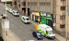 Police and ambulance crews at the scene of the bizarre incident.