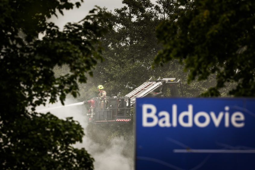 Hoses being used to tackle the fire at Baldovie Industrial Estate.
