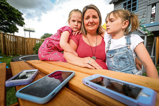 Eva and Posy Hann were targeted on a phone app called Wink, with inappropriate messaging of a sexual nature sent to the two children, discovered by mum Emma.