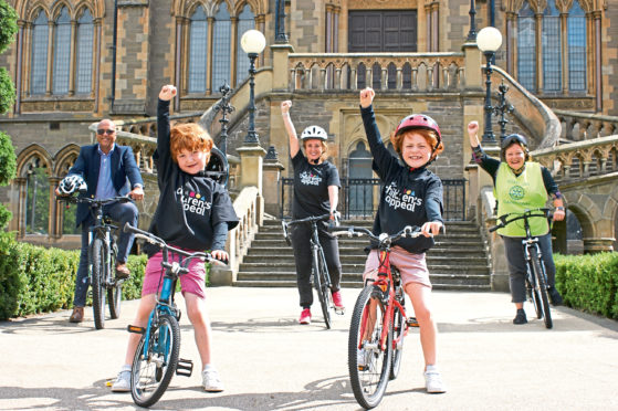 Picture shows (back, from left) Abi Abubaker of Al Maktoum College, Martel, Pat O'Connor of Rotary Club of Claverhouse who organise the Cyclathon, with Martel's sons Monty, 7, and Chester, 5.