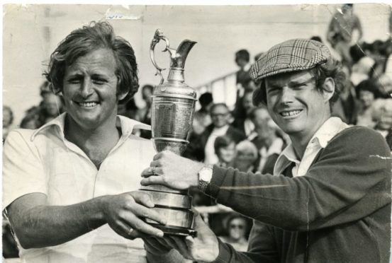Jack Newton and Tom Watson hold the Claret Jug at Carnoustie.