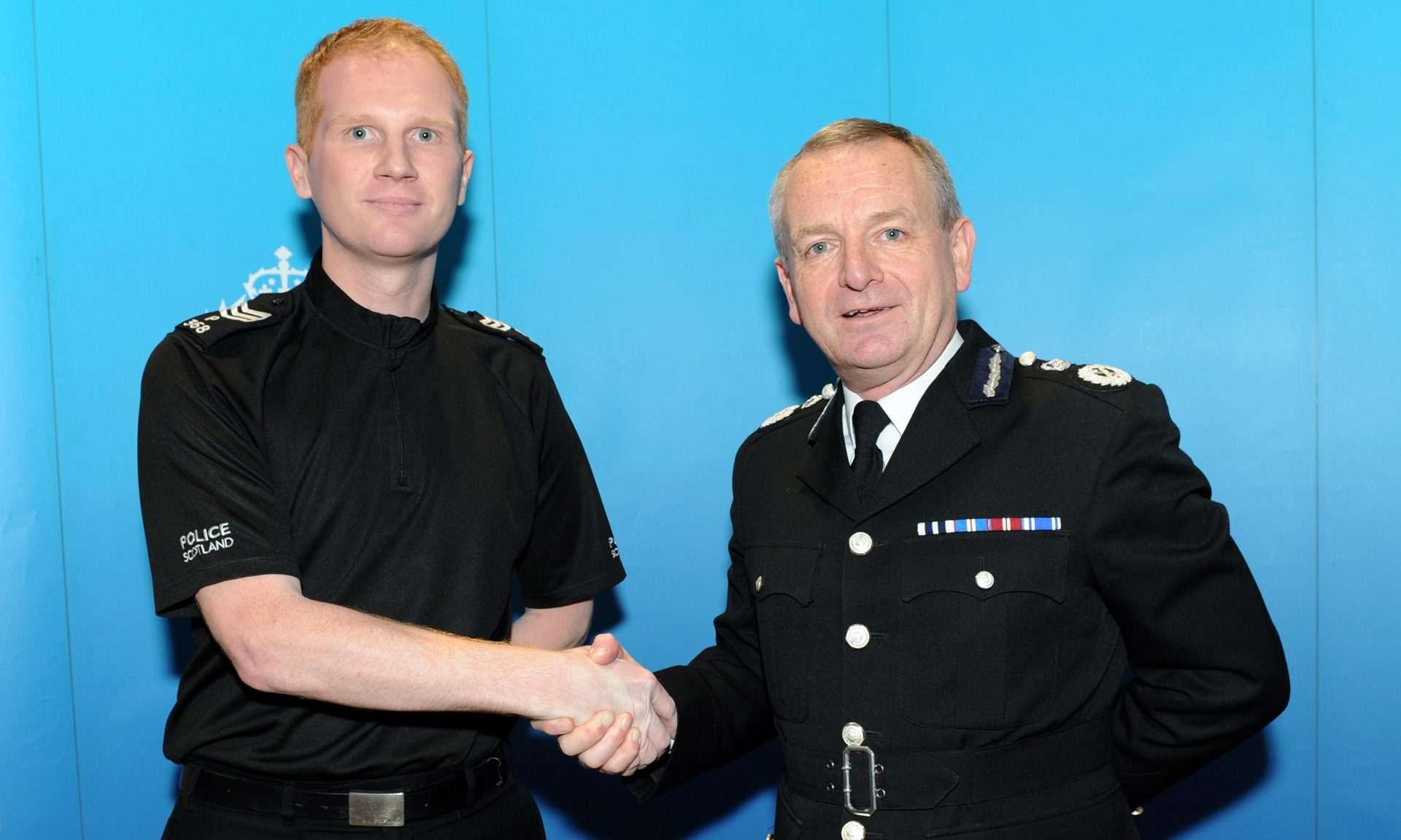 Inspector Chris Mutter with Chief Constable Iain Livingstone.