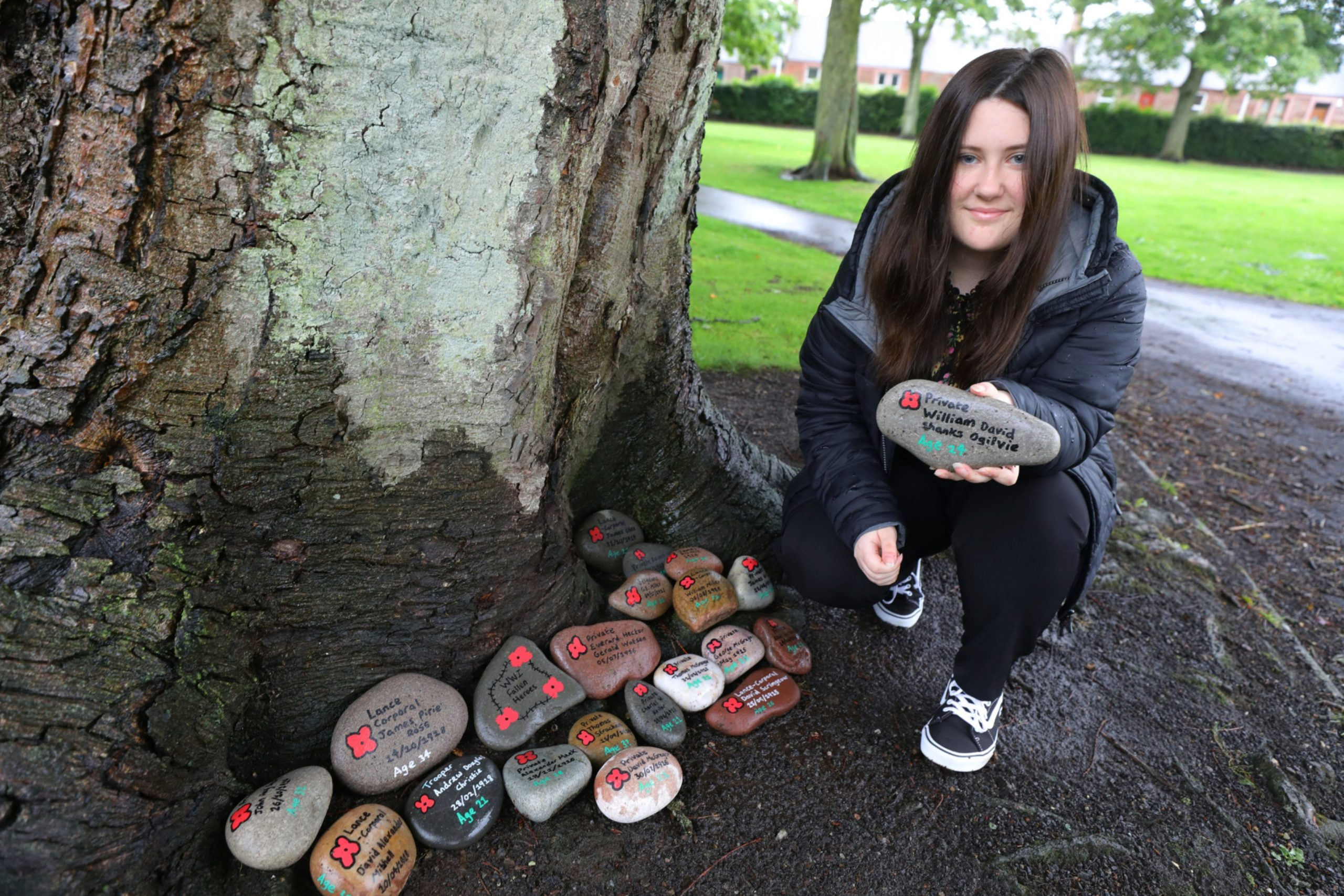 Eilidh Bowen beside some of her stone memorials, in Hayswell Park in Arbroath.
