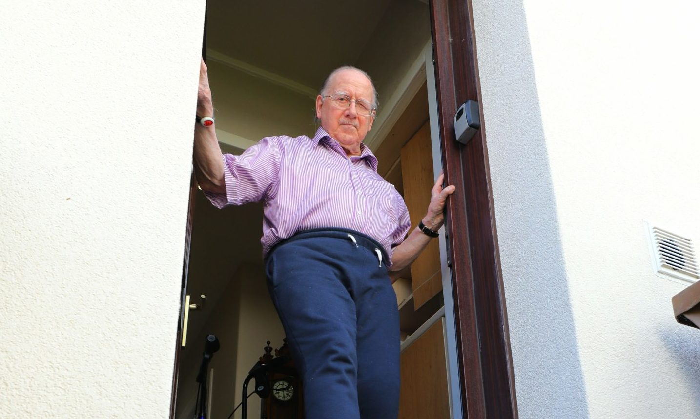 82 year old Robert Milroy at the door of his house on Arbroath Road in Dundee where he is complaining about the lack of a temporary ramp, which has meant he has been housebound since November.