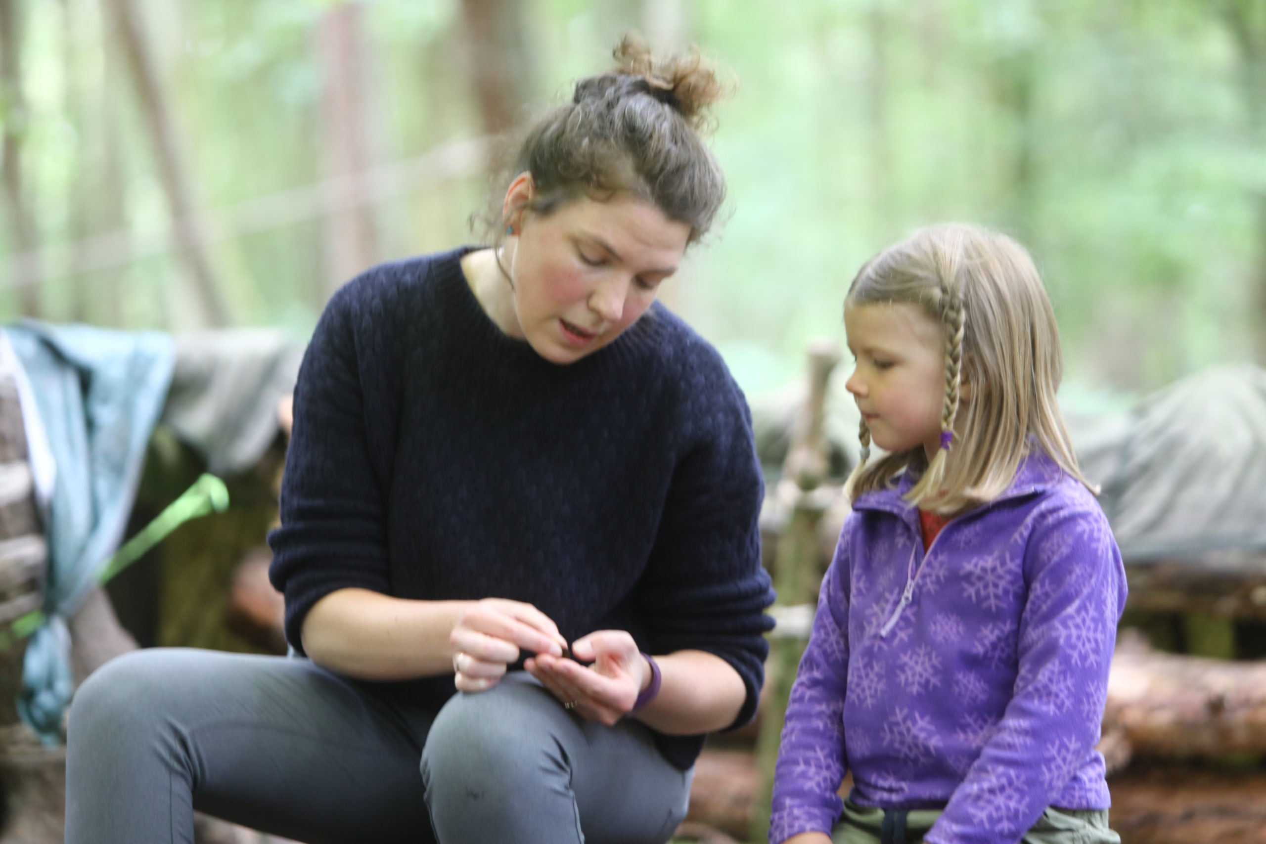 Sarah Latto - Manager chatting with one of the kids, at the Secret Garden Outdoor Nursery, near Letham in Fife.