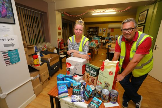 Niki Lamond - Manager with George McIrvine - staff member, with some of the items Haven will distribute (Dougie Nicolson / DCT Media.)