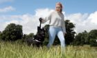 Lucy Hope Carbary-Johnson (18) walking her dog Cassie through Baxter Park