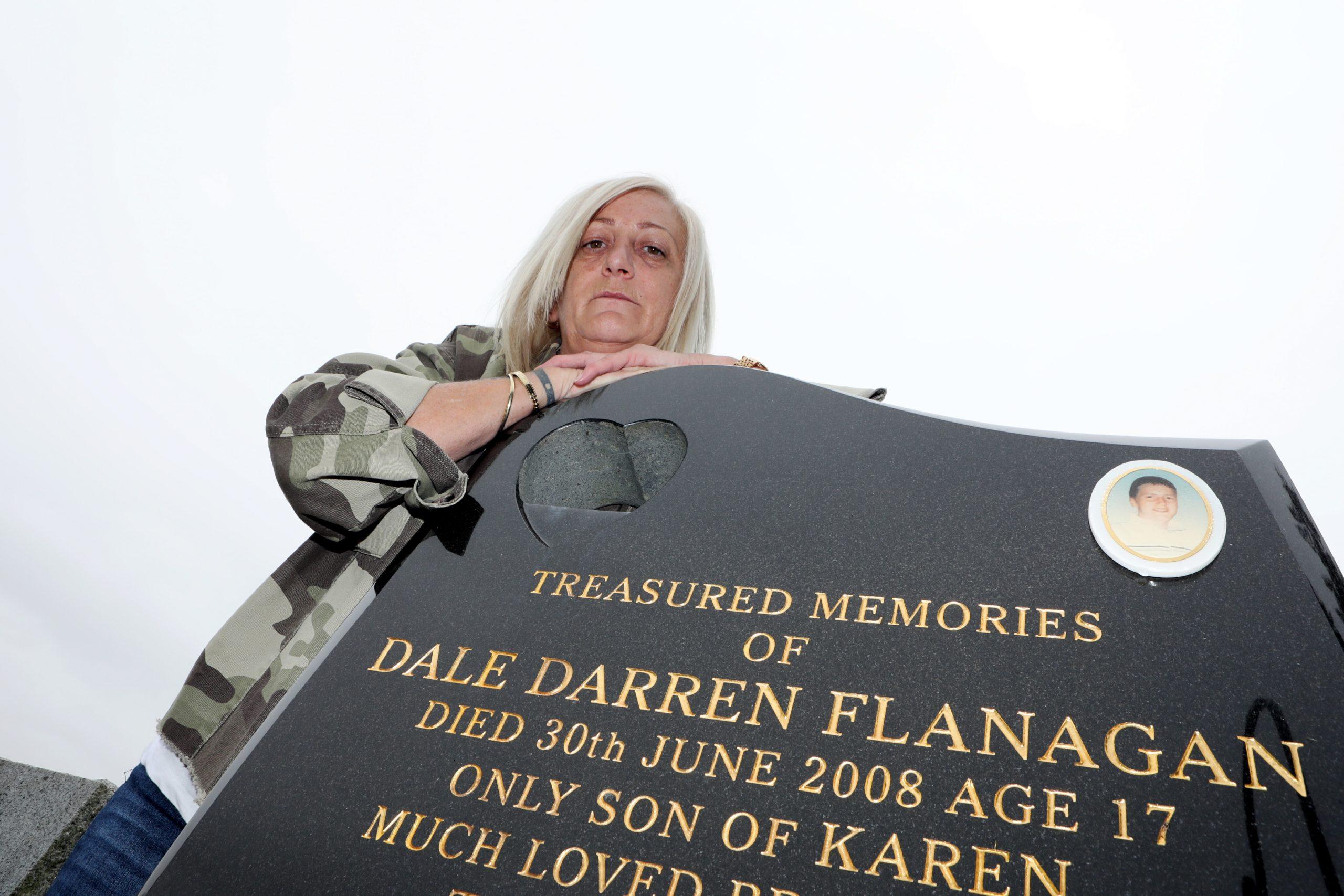Karen Longmuir at her son Dale's grave.