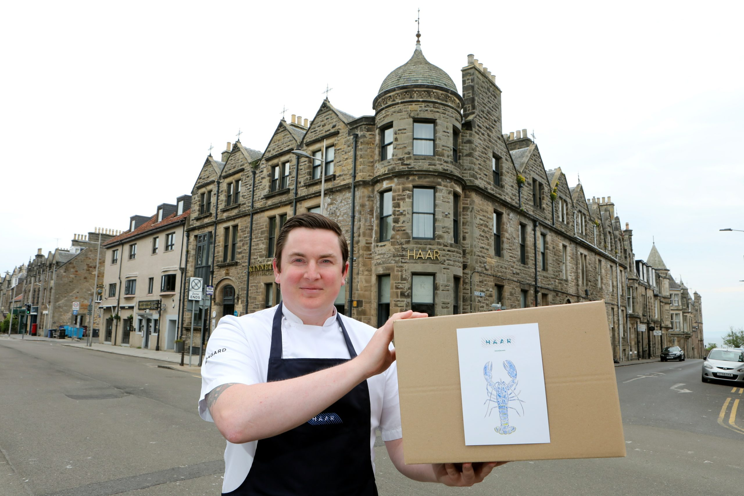 Dean Banks with his Haar at Home fine dining boxes.