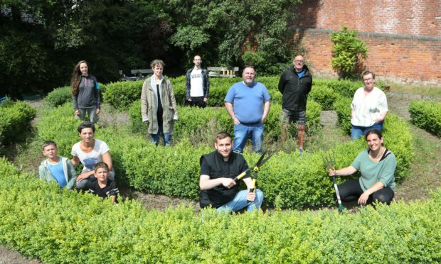 Tomasz Cackd (centre) in the Forebank Pocket Garden where along with  other volunteers.