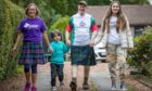 Derek and Patricia Stewart who will be taking part in the first virtual Kiltwalk are pictured with grandchildren Aaron Henderson, 4, and Farrah Henderson, 11.