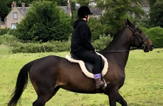 Kym riding Rose.