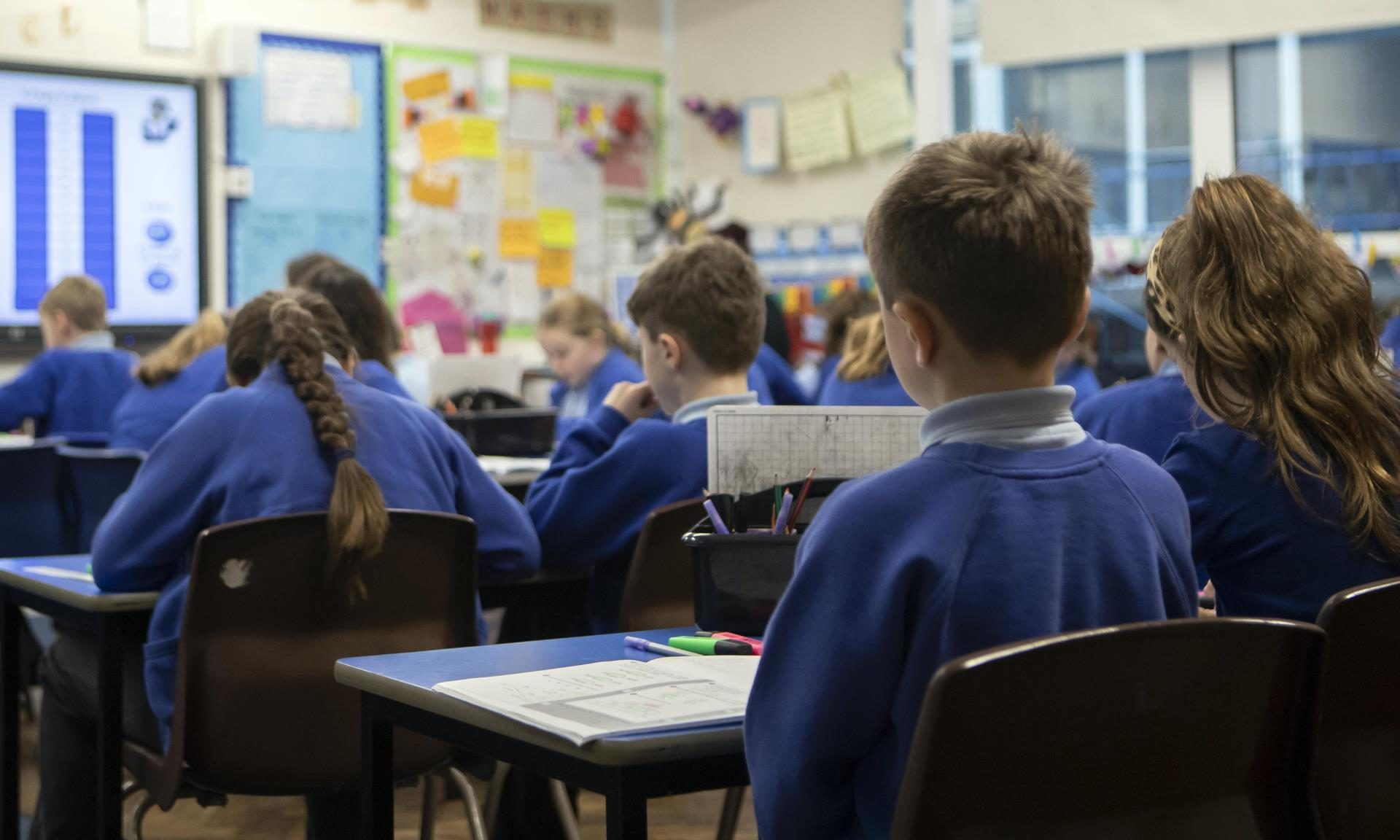 "EMBARGOED TO 0001 MONDAY JULY 20 File photo dated 27/11/19 of school children during a Year 5 class at a primary school. Schools may feel like a ""strange place"" to pupils when they return next month due to safety measures amid the coronavirus pandemic, a leading psychiatrist has warned."