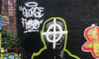 The mural to George Floyd, which had a racist symbol painted over Mr Floyds face and the word 'black' defaced.