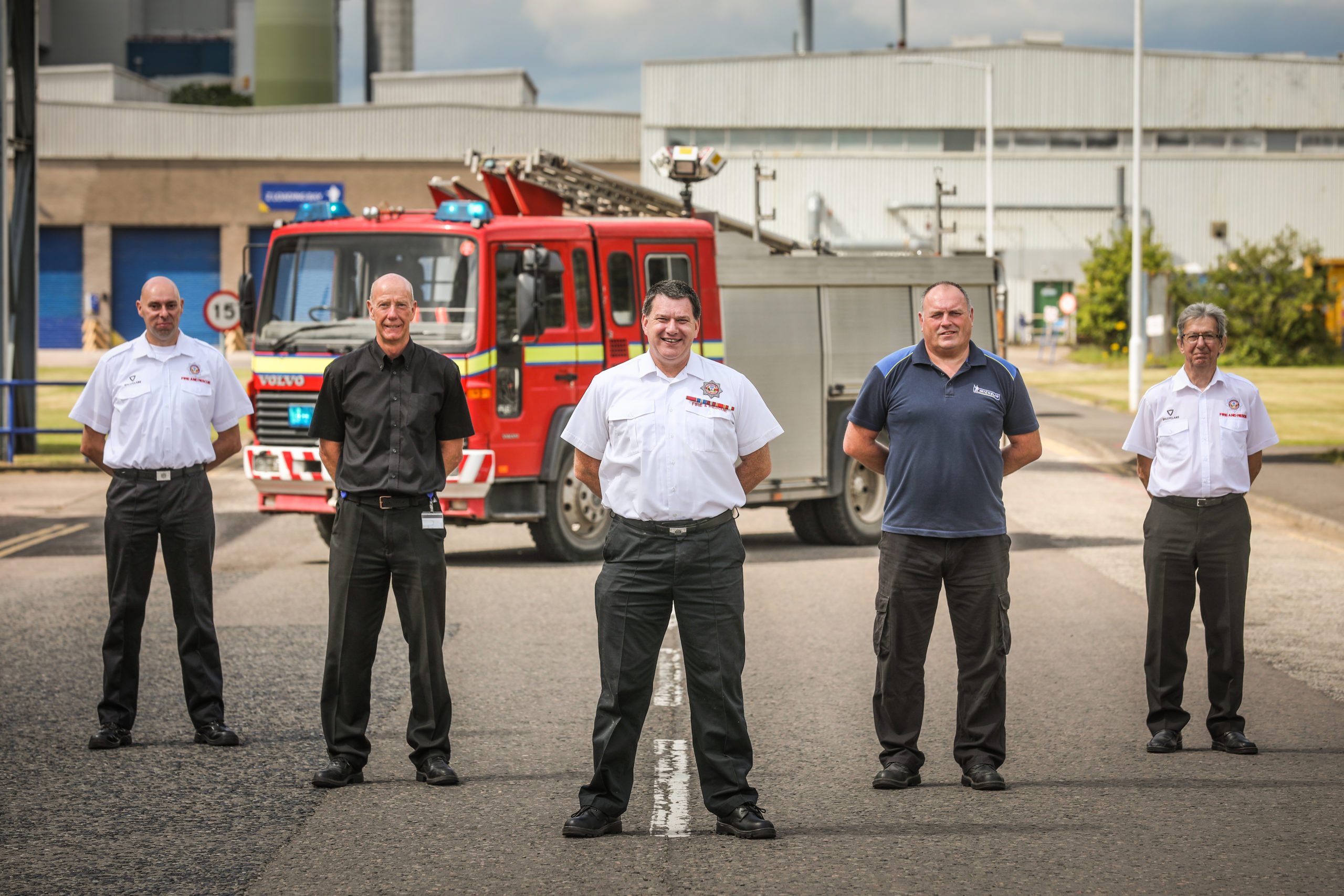From left: Gary Johnstone, of IFRA, Geoff Petrie, who's in charge of Michelin's fire and security, David Kay, director of IFRA, Michelin security officer Steve Blaney and former Michelin employee and member of IFRA, Alan Kay, with one of the engines.