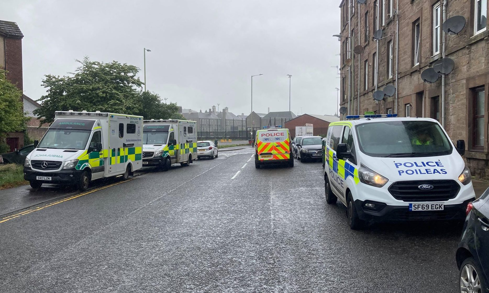 Two ambulances and two police vans were seen at the scene, with other police vehicles witnessed coming and going.