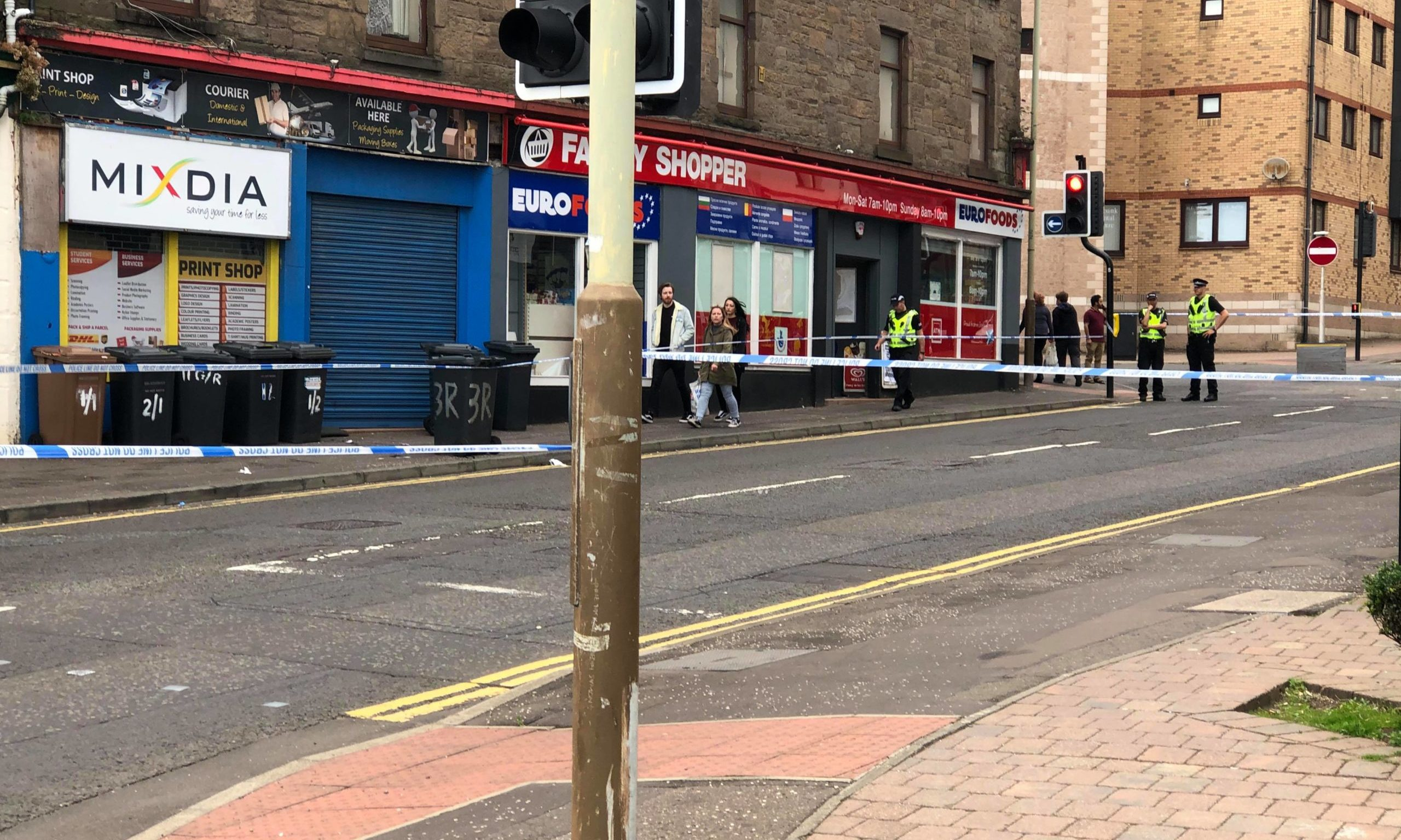 A police cordon is in place at Hilltown, near to the junction with Constitution Street.