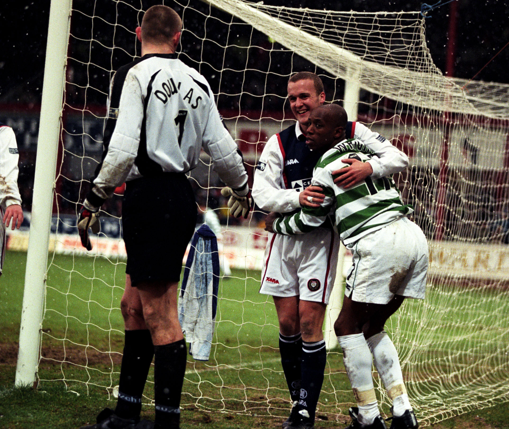 Celtic's Ian Wright is helped to his feet by Steven Boyack and Robert Douglas in 2000