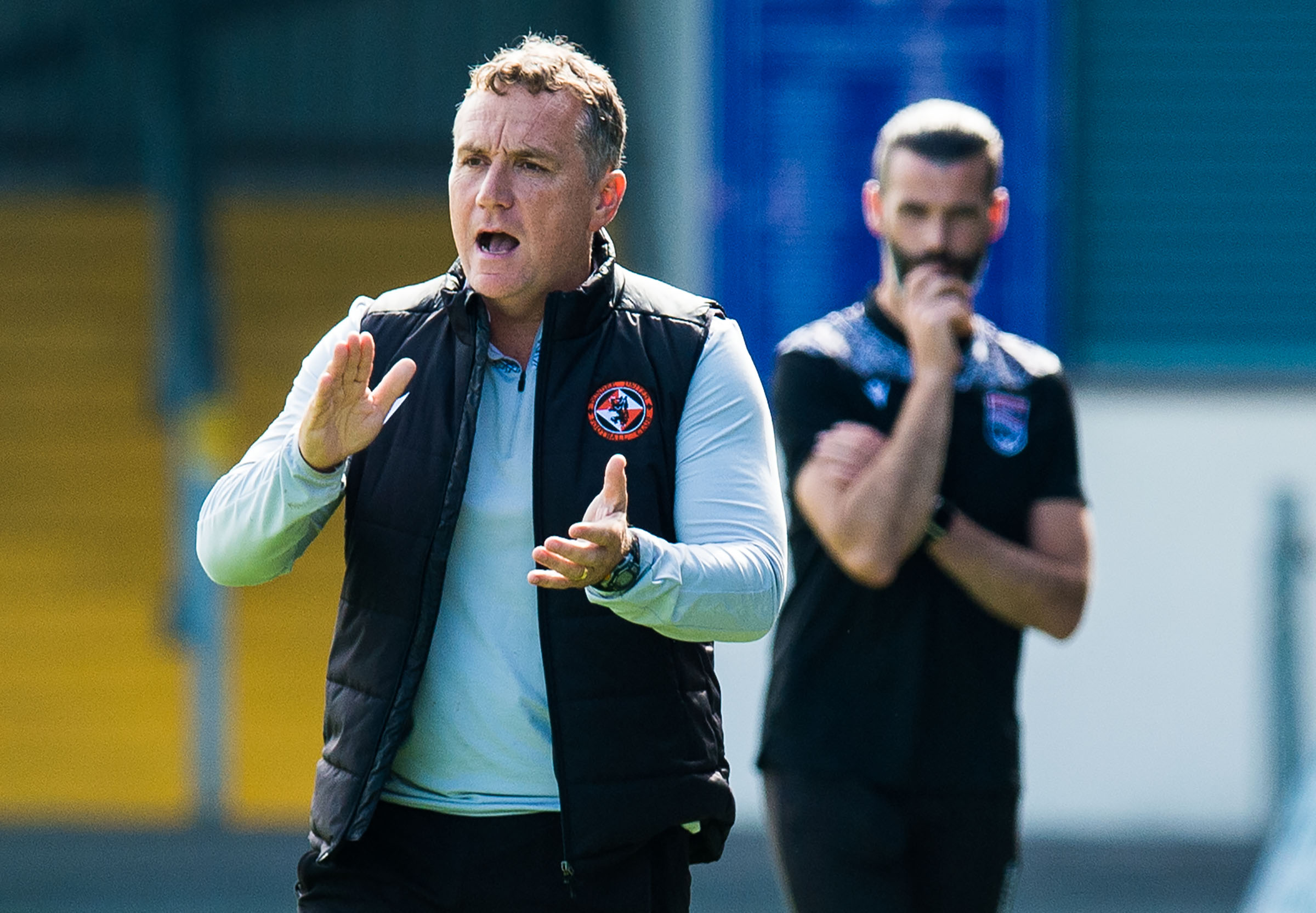 Dundee United manager Micky Mellon encourages his troops from the touchline.