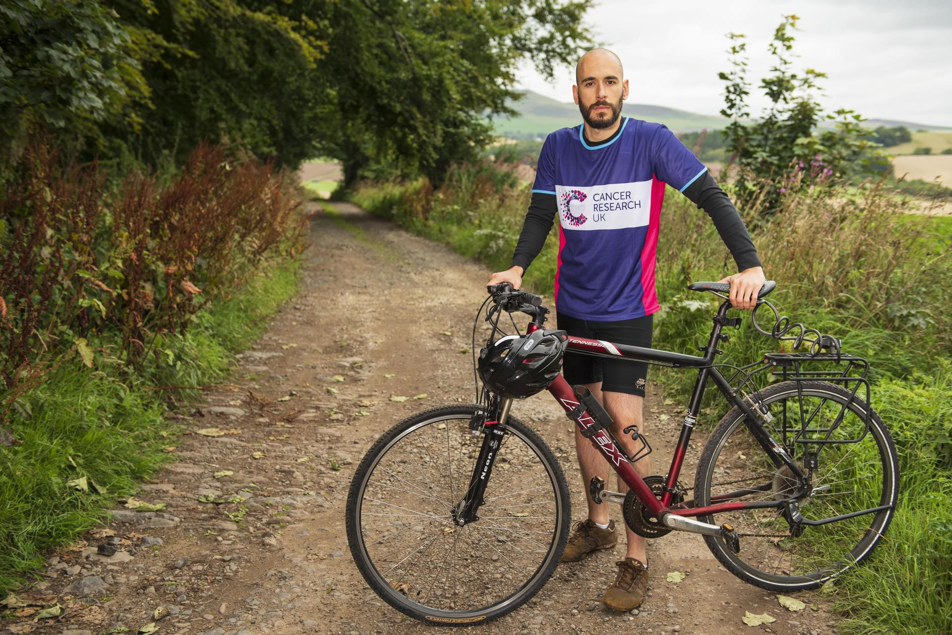 University of Dundee cancer researcher Dr Laureano de la Vega getting on his bike to promote Cancer Research UK 300.
