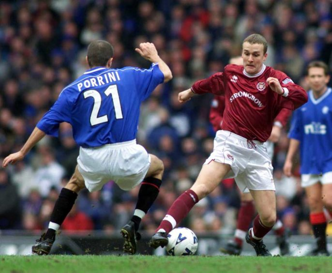 Boyack in action for Hearts against his former club Rangers.