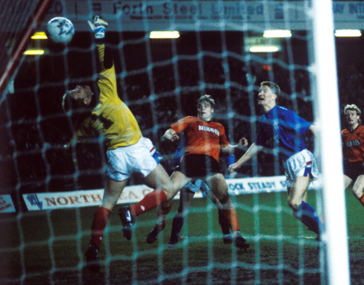 Mixu puts the ball past Rangers keeper Chris Woods at Ibrox in 1989.