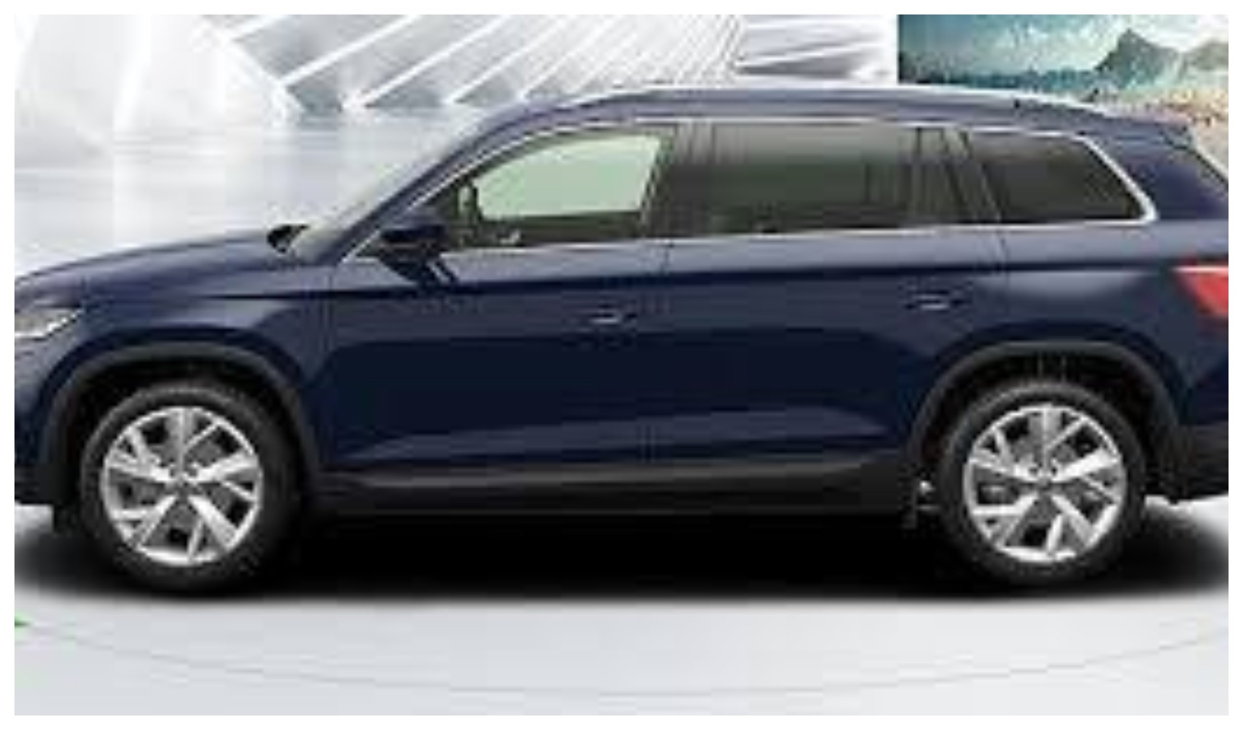 The car is a blue Skoda Kodiaq, similar to the one pictured.