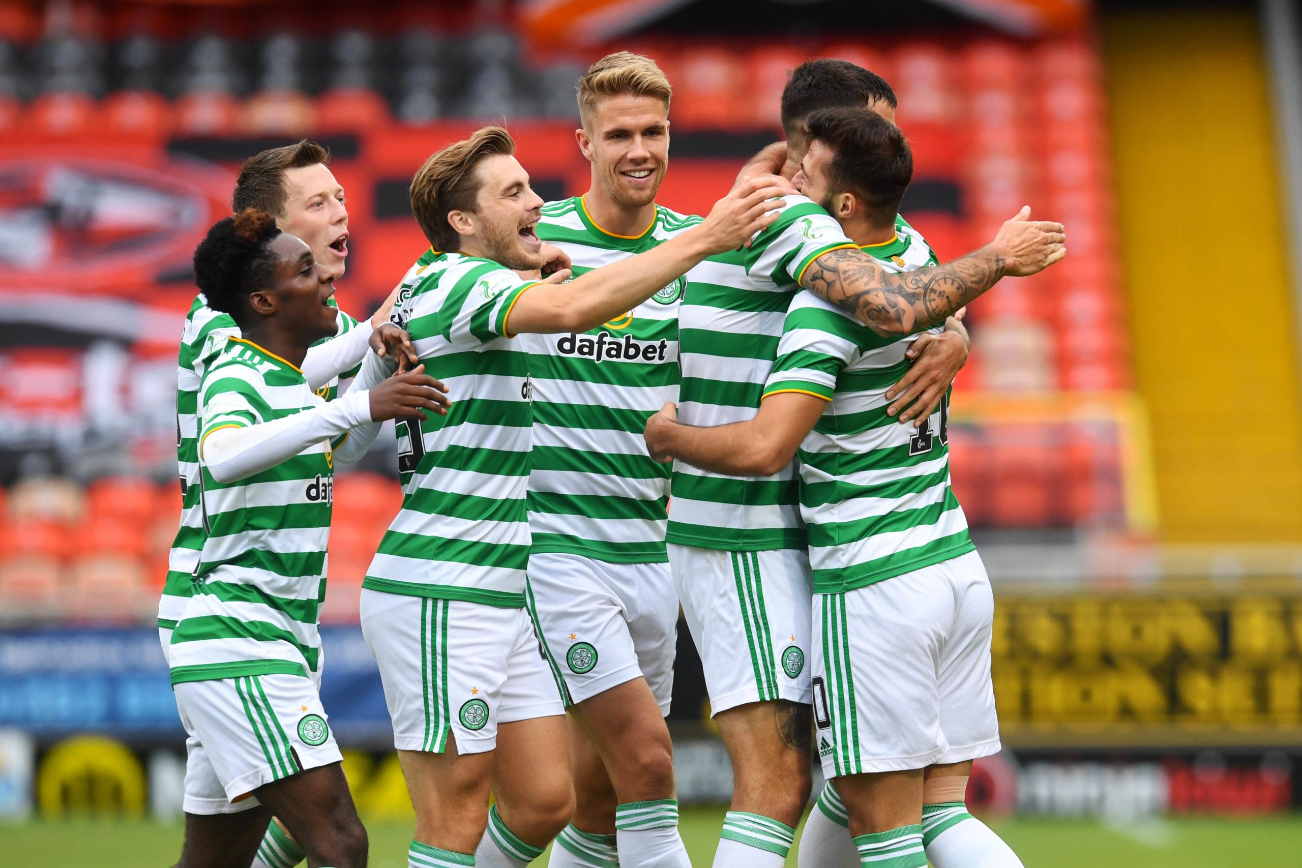 Celtic celebrate Albian Ajeti's (far right) winner.