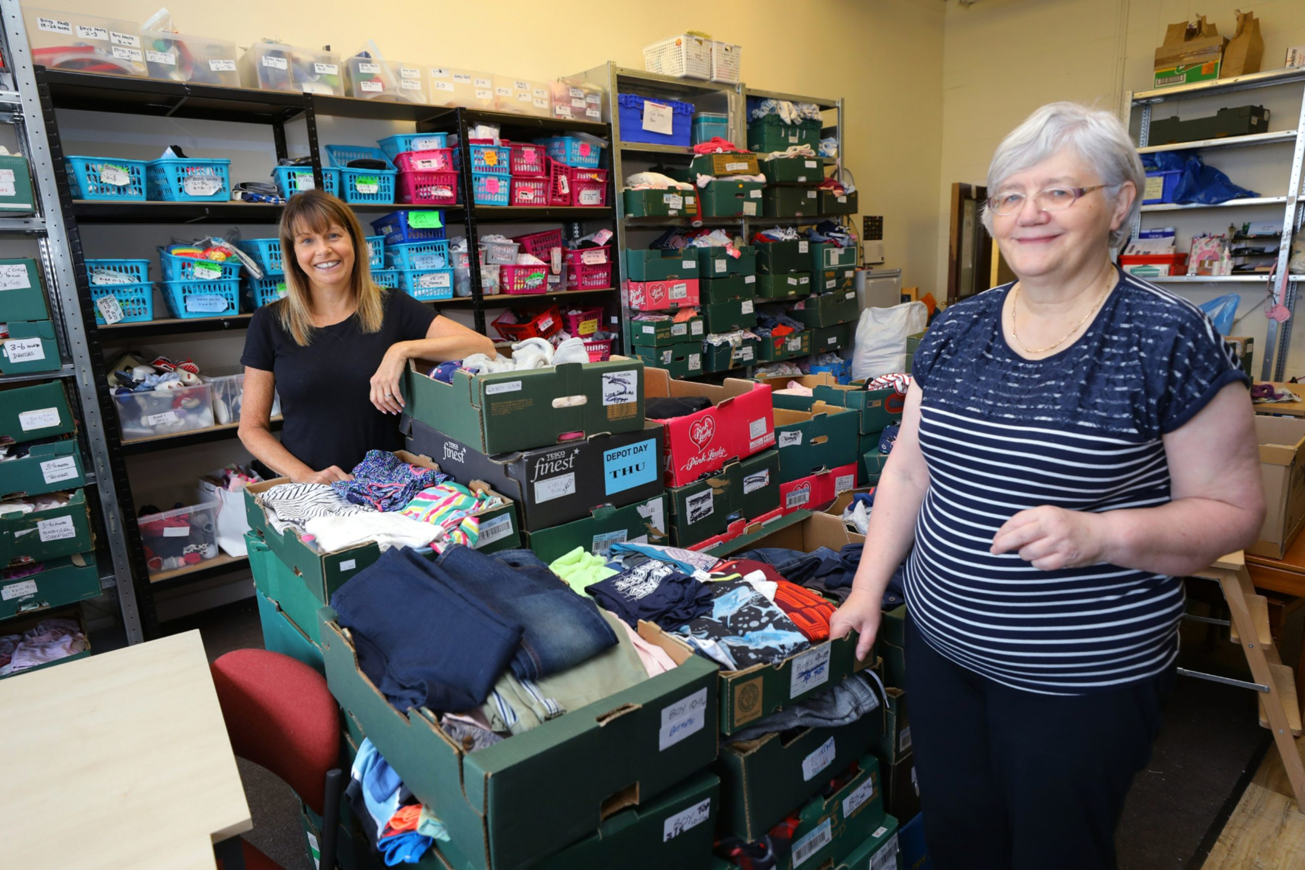 Picture shows; volunteers Karen Lees, left, and Tilly Duke at Togs For Tots, at The Circle in Dundee.