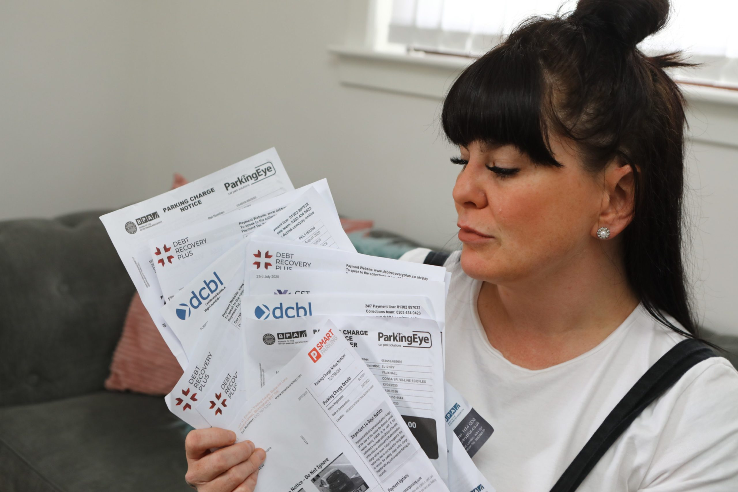 Vicky McGuire at home in Dundee today, with all the correspondence relating to her parking fines.