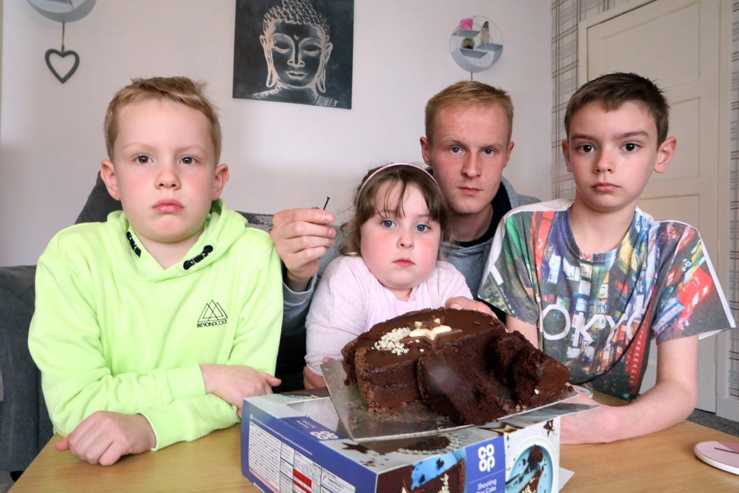 Jack Winstanley (7) , Olivia Watson (5) & Harry Winstanley (10),  when he discovered a nail inside the Co-op cake.
