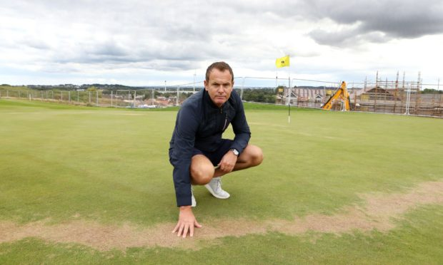 Course manager Allan Bange on the 13th green which has been badly sprayed with something which has damaged the grass.