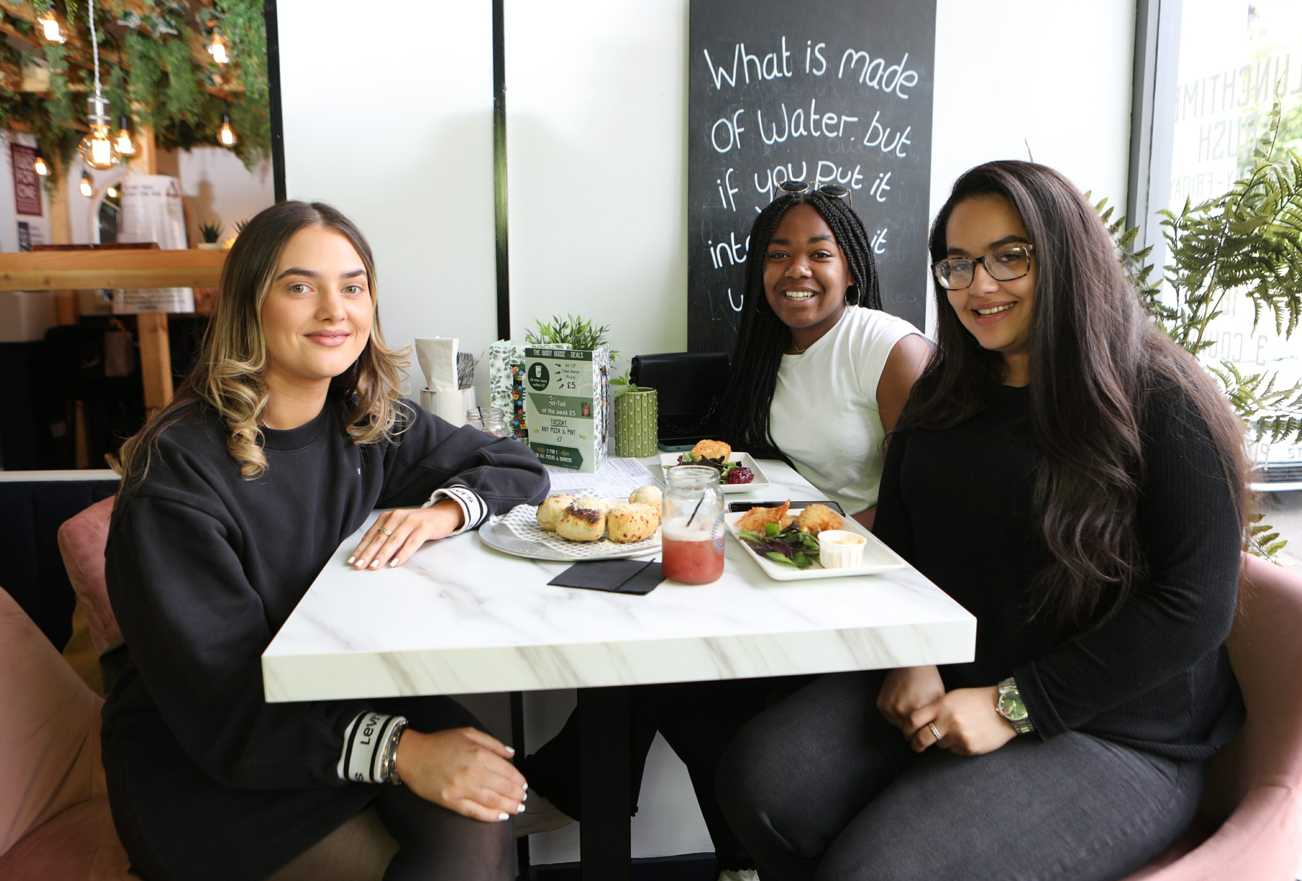Courtney Buchan, Lauren Banks and Lara Laayouni, all aged 21, enjoy a meal at the Giddy Goose.